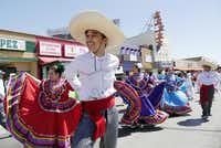 Alex Guerrero, 14, with the L.V. Stockard Middle School Dance Company, moves down Jefferson Boulevard in the Dallas Cinco de Mayo Parade.Ron Baselice  -  Staff Photographer