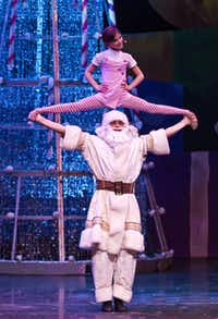 Performers dressed as Santa and Santa's little helper perform acrobats during a performance of 'Cirque Dreams Holidaze' at the Winspear Opera House in Dallas, Tuesday, December 18, 2012.