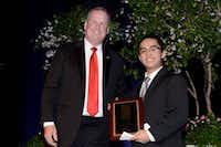 Matt Kramer, president and CEO of the Catholic Foundation, presents a Scholar Award to Phong Nguyen of Cistercian.(Photo submitted by the Catholic Foundation)