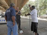 A crisis intervention team member and a Dallas police officer talk with a homeless man. For some, living under a bridge is more appealing than staying in a shelter.Ron Baselice  -  Staff Photographer