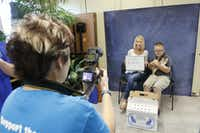 """Bethany Cinotto and her son Kylen Kraus (10 years old) have their picture taken with their new cat """"Scotch"""" during  the Clear the Shelter event at Prairie Paws Adoption Center in Grand Prairie, Texas on Saturday, Aug. 15, 2015. The event was created to increase the rate of pet adoptions. (Lawrence E. Jenkins/Special Contributor)(Lawrence E. Jenkins - Special Contributor)"""