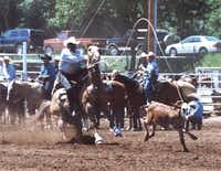 Cleo Hearn ropes a calf in South Dakota in 2002.Photo submitted by Cleo Hearn