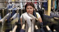 Janice Compos of Garland looks for clothes for her family at Network of Community Ministries in Richardson.