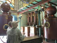 At the Asbach Visitors' Center in Rüdesheim, Germany, visitors are shown an example of the copper stills used to produce the award-winning brandy.( Susan Farlow  -  Special Contributor )