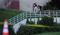 Police investigate outside a movie theater after a shooting Friday, July 20, 2012 in Aurora, Colo.