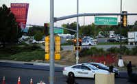 Police cars line the streets after a shooting at a movie theater, Friday, July 20, 2012 in Aurora, Colo.