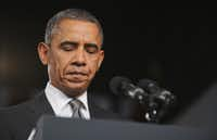"""US President Barack Obama pauses as he speaks on the shootings in Aurora, Colorado at what was scheduled originally as a campaign event at Harborside Event Center July 20, 2012 in Fort Myers, Florida.  """"Such violence, such evil, is senseless. But while we will never know fully what causes somebody to take the live of another, we do know what makes life worth living,"""" he told a somber crowd in Florida."""