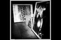 Framed enlargements of prints from Laura Wilson's Grit and Glory: Six-Man Football series are stored in an unused room.
