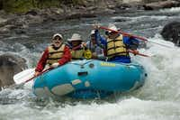 Grinning river rats splash through Toilet Bowl Rapid on the Taylor River southeast of Crested Butte, Colorado.  Raft trips on the upper river offer plenty of Class III thrills