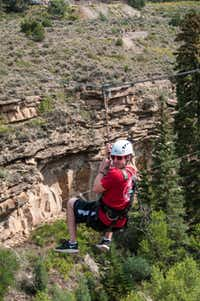 A guest zips across the canyon outside Vail, Colorado.  Runs here reach 20-story heights and stretch 1,000 feet from end to end.