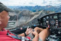 Pilot Bob Saunders sits at the controls of his glider over  Telluride, Colorado.  While the mountains appear grand from below, they're absolutely spectacular when seen from above.