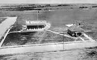 This 1911 photograph shows the first commercial building, and only the fourth structure of any type, to be built in the new suburban area of Highland Park. The main office building is at left and the caretaker's house at right. The lot at the corner of Abbott and Gillon avenues was bought from developer John S. Armstrong for $1,500 by two insurance companies, which later consolidated with a third company to form Republic Insurance Co.