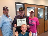 """Jack """"Cotton"""" Futrell shows off the honorary diploma he received from the Mesquite ISD trustees on Monday night. With Futrell is his son Greg, left, his wife Mary and his great grandson Cayden.Futrell family"""