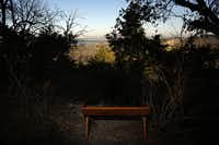A bench built by local Eagle Scouts overlooks the view of Joe Pool Lake at the Dogwood Canyon Audubon Center at Cedar Hill.