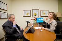 Parkinson Voice Project Founder and CEO Samantha Elandary (right) encourages Parkinson's patient David Cid to speak louder during a speech therapy session at the Parkinson Voice Project in Richardson.( photo by Brandon Wade  - special contributor)