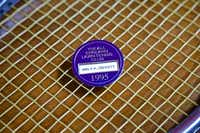 Nancy Jeffett's Wimbledon Members pin sits on top of her tennis racket at her home in Dallas.( Brandon Wade  -  Special Contributor )