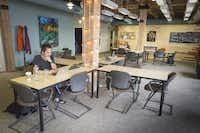 Alex Chang and freelance journalist Tamar Wilner (background) work at The Grove, a co-working space. Developers and entrepreneurs believe there is strong demand for co-working spaces in the Dallas-Fort Worth area, given the region's economy and changing demographics.(Ron Heflin - Special Contributor)