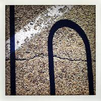 Amon Carter Museum parking lot with bicycle rack shadow