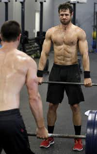 Don Walker (right) and Trey Kubacak (left) of the CrossFit Dallas Central team do deadlifts at CrossFit Gym. The CrossFit phenomenon, first planted its Dallas roots four years ago. The high-intensity sport combines exercise routines from Olympic weightlifting, gymnastics, rowing and swimming, the goal being to diversify movements and constantly place the body in new scenarios.