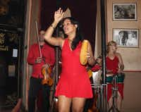 A salsa band plays at Floridita's, a bar where Ernest Hemingway hung out in Havana. The singer is using a giro, Latin-American percussion instrument. The hole in one side lets it convert into an impromptu tip jar, passed around after the show.( Joy Tipping  -  Staff )
