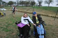 Alex Dagley visits with Stephanie Kilgore, a friend who also has FA, at the 2013 Ride Ataxia Dallas.(Photo submitted by ALEX DAGLEY)