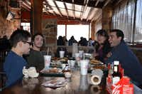 """Dagley family members, from left, Alex, Jason, Lisa and Adam, share a laugh while out to eat at a favorite area restaurant. """"We try to make every day as good as it can be,"""" Eric Dagley said.Photo submitted by ERIC DAGLEY"""