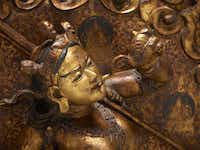 """""""Dakini of All the Buddhas (early 19th-century copper alloy, hammered high relief,black and red lacquer, red paint) displays almost wrathful demeanor."""