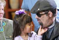 Face transplant patient Dallas Wiens lets his daughter, Scarlette, check out his goatee at Brigham and Women's Hospital in Boston Monday.