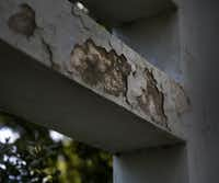 Chipped paint and cracked plaster can be seen on the south pergola in Dealey Plaza.