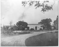 This image, dated 1940, shows the driveway and gardens leading to the DeGolyer Estate near White Rock Lake in Dallas.
