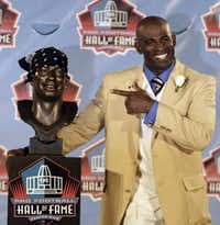 Deion Sanders and his doo-ragged Pro Football Hall of Fame bust. (AP file, Aug. 6, 2011)