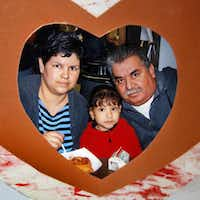 A photo of Mariano Saldivar with his wife and daughter hangs on the refrigerator in the West duplex his family has made its home with the help of friends and strangers.Tom Fox  - Staff Photographer