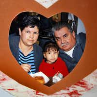 A photo of Mariano Saldivar with his wife and daughter hangs on the refrigerator in the West duplex his family has made its home with the help of friends and strangers.( Tom Fox  - Staff Photographer)