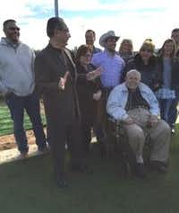 Dick Lear, in wheelchair, at a ceremony honoring him at Irving High School