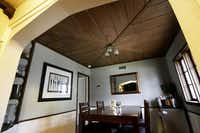 Jana and Scott Boyles'  home has a paneled ceiling in the dining room, a ceiling beam in the living room and a Dutch door to help keep the house cool.(Rose Baca - Staff Photographer)