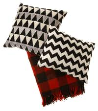 Bedtime stories: Crewel zigzag pillow ($39), Magical Thinking triangle pillow ($44) and Faribault Woolen Mill's wool plaid blanket ($159), made in Minnesota, are found at Urban Outfitters and urbanoutfitters.com.Evans Caglage - Staff Photographer