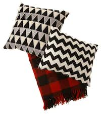 Bedtime stories: Crewel zigzag pillow ($39), Magical Thinking triangle pillow ($44) and Faribault Woolen Mill's wool plaid blanket ($159), made in Minnesota, are found at Urban Outfitters and urbanoutfitters.com.(Evans Caglage - Staff Photographer)