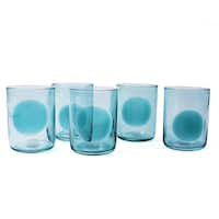 Dotty nod to the '60s: Hand-blown Dot glasses are available in sunny citrus colors and cool blues. The dots are applied by hand, so no two are exactly alike.