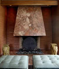 The hearth in the living room is flush with the floor. It features the same marble as the hood.