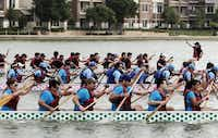 Teams compete in the dragon boat races at the DFW Dragon Boat, Kite and Lantern Festival in Las Colinas.Photo by BRANDON WADE  -  DMN Special Contributor