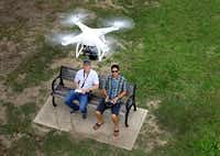 W. Ross Cromartie (left) and Payne Wingate demonstrate the use of a drone at White Rock Lake. Their Dallas company, SkyLVL, produces photos and videos by using unmanned aircraft to get sky-high angles.( Tom Fox  -  Staff Photographer )
