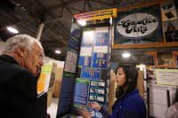 "Retired chemist Cary Begun, left, visits with student Shriya Beesam, 13, of Otto middle school, to judge her science project for the 2014 Dallas Regional Science and Engineering Fair, on Saturday, Feb. 15, 2014 at Fair Park in Dallas. The science project was titled, ""can bacteria battle the plastic epidemic?"" The fair serves more than 80 school districts, 41 charter schools, over 100 private schools, as well as home schooled children in Dallas."