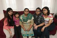 The family of Mohammad Naveed Haider, a Far East Dallas shopkeeper who died after being shot in a November robbery, may not be able to keep the store open. His wife, Bushra, is surrounded by daughters (from left) Biya, 18; Safa, 7; Noor, 16; and Maha, 17.