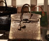 Auctioneers expect a Hermés ombre lizard Birkin bag to draw big offers.