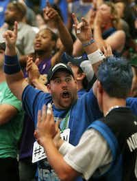 Mavericks fan Thad Bouton cheers for his team during the watch party at the American Airlines Center in Dallas for Game Six of the NBA Finals between the Dallas Mavericks and the Miami Heat in Miami on Sunday, June 12, 2011.