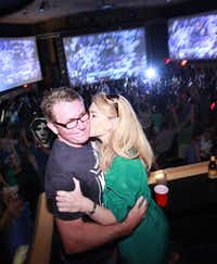 Former Dallas Police Chief and current mayoral candidate, David Kunkle, and his wife Sarah Dodd celebrate the Mavericks win at the Granada Theater in Dallas, TX, on June 12, 2011.