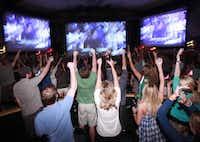 Fans celebrate the Mavericks game at Granada Theater in Dallas, TX, on June 12, 2011.