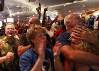 Dallas Mavericks fans at Champps in Addison, Texas erupt with joy when the Mavs won the NBA finals beating the Miami Heat Sunday night, June 12, 2011. Left to right:  Amy Hiser, center, Terry Davis, hugging Michele Shanahan.