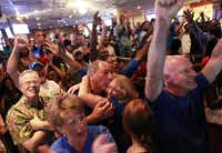 Dallas Mavericks fans at Champps in Addison, Texas erupt with joy when the Mavs won the NBA finals beating the Miami Heat Sunday night, June 12, 2011.  Cathy Ramsey and Richie Mattoni (center) hug  and celebrate the Mavs win.