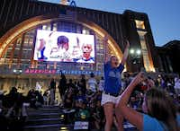 Tasha Savage and Savannah Gandee cheer for the Mavs as they watch the game outside on AT&T Plaza during the watch party at the American Airlines Center in Dallas for Game Six of the NBA Finals between the Dallas Mavericks and the Miami Heat in Miami on Sunday, June 12, 2011.